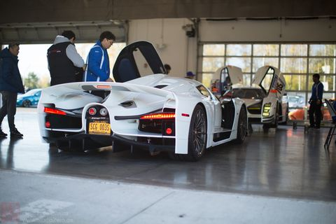 The 2018 SCG 003s getting ready to head out on to the Monticello track with the crew in the garage.