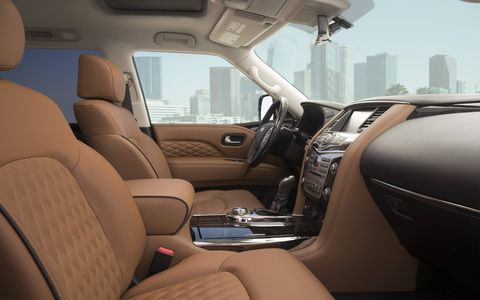 The 2018 Infiniti QX80's interior is full of soft leather and luxe-looking wood accents.