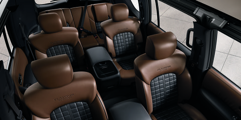 The 2018 Nissan Armada Platinum has 16.5 cubic feet of trunk space, 49.9 if you put down the third row and 95.4 cubic feet with the second row folded too.