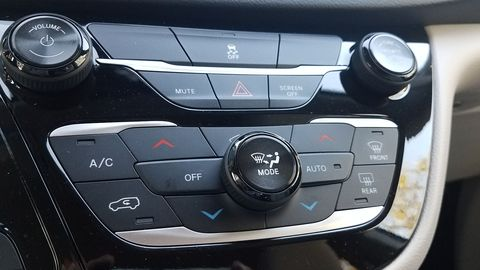 Typical Chrysler HVAC/audio controls here.