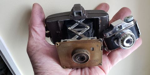 On the left, the 1938 Univex AF-5. On the right, one of the 400+ types of Hit camera made from the late 1940s through the early 1970s.