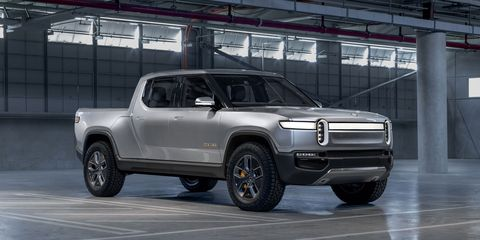 The Rivian R1T electric pickup gets 400-plus miles of range and a motor at each wheel.