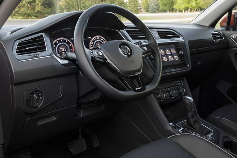 Front-wheel drive 2018 Volkswagen Tiguan crossovers come with three rows of seating, including a second-row bench that can recline, slide seven inches fore and aft, fold down, and be split 40/20/40.