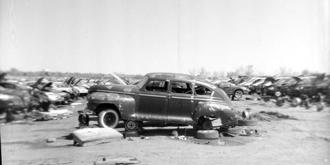 Postwar Detroit sedans aren't worth much as restoration projects, so a surprising number still show up in America's big self-service wrecking yards. This one ends its days next to a 21st-century Dodge Stratus in Denver.