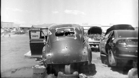 A 1948 Plymouth sedan in a Denver wrecking yard, photographed with a 1939 Falcon Miniature film camera.