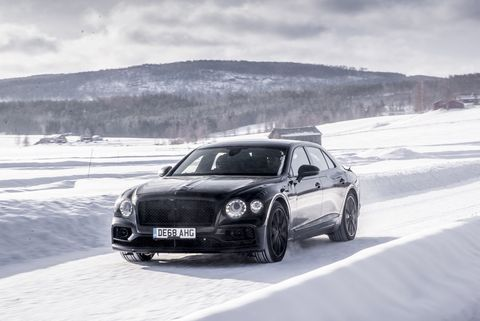 The 2020 Bentley Flying Spur showing off its new athletic stance against the white Sweden snow. It's March 2nd 2019.