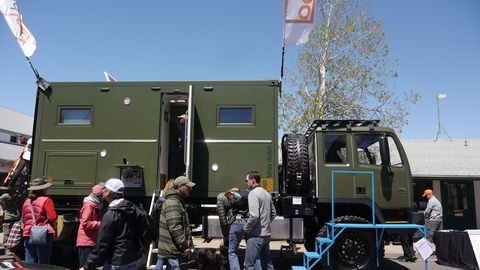 This Acela Monterra is a fully refurbished M1078 LMVT military truck with a cozy camper box on the back.