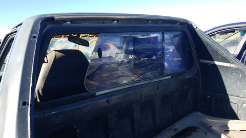 This appears to be a snazzy aftermarket sliding rear window.