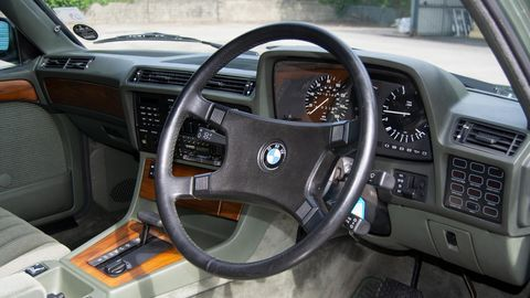 Land vehicle, Vehicle, Car, Steering wheel, Luxury vehicle, Steering part, Sedan, Center console, Performance car, Coupé,