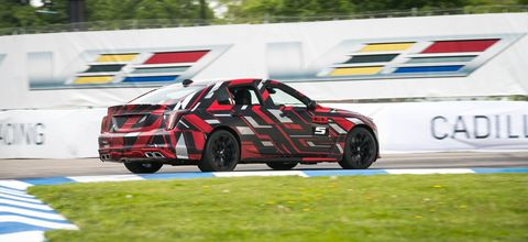 """Cadillac brought camouflaged CT4-V and CT5-V prototypes to the Detroit Grand Prix for s surprise lap of the circuit. As for specs, we don't have anything to go on except for the promise that these cars represent """"the next step in Cadillac's V-Series performance legacy,"""" but we hope the dazzle wraps conceal a good dose of extra power."""