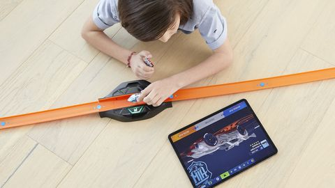 """<span style=""""font-size:11pt""""><span style=""""line-height:107%""""><span style=""""font-family:Calibri,sans-serif"""">Each Hot Wheels id vehicle embedded with an NFC chip has a unique digital identity that can be recorded on the owner's tablet or smart phone via a new app, like digitally registering your little diecast car at the Hot Wheels DMV. If you sell or trade your id to someone else, they can register it under their name.</span></span></span>"""