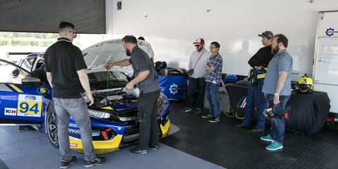 Motor vehicle, Automotive design, Vehicle, Car, Radio-controlled car, Team, Race car, Radio-controlled toy, Competition event, Sports sedan,