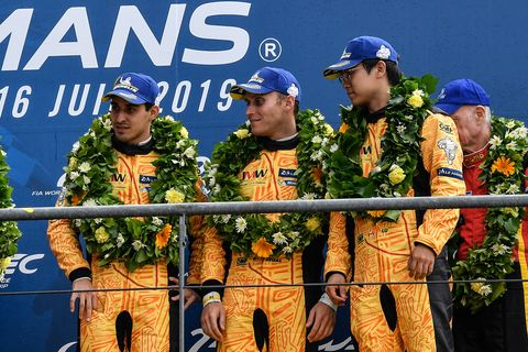 Wei Lu celebrates with teammates Jeff Segal and Rodrigo Bapbista on the podium of the201924 Hours ofLe Mans
