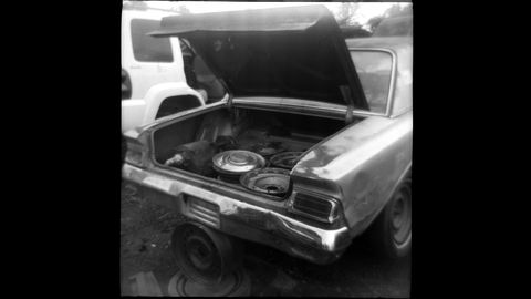 In the trunk, many Rambler hubcaps and a spare transmission.