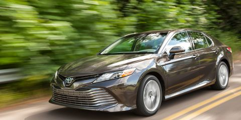 The 2019 Toyota Camry Hybrid XLE comes with an I4 and an electric motor putting out a total of 208 hp.