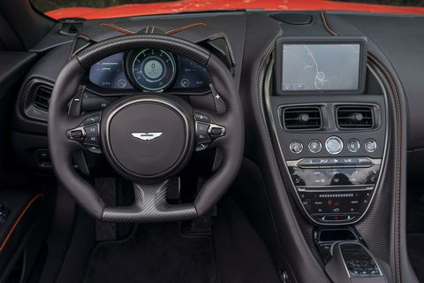 The2019 Aston Martin DBS Superleggera Volante's interior is just as visually strikingas the exterior