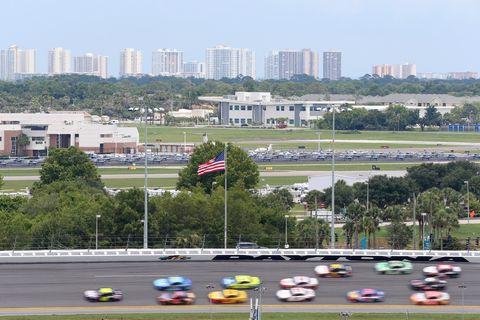 Race track, Metropolitan area, Urban area, Skyline, City, Sport venue, Vehicle, Urban design, Racing, Thoroughfare,