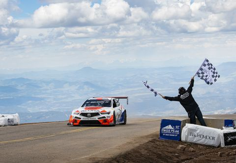 Veteran race car driver Peter Cunningham heads up the mountain for a third time and wins his class for the third time.