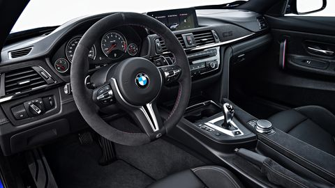 The 2019 BMW M4 CS gets a few special touches inside, like the punch-out CS logo in the dash.