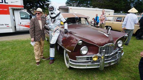 Packard, robot, scientist (R to L)