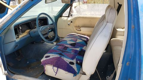 That seat cover looks like something bought at K-Mart in 1977. The vinyl underneath looks good.