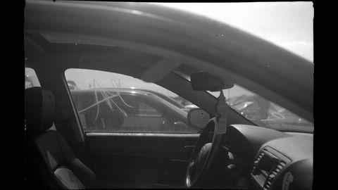 Photographs taken with 1939 Franka Bonafix film camera in a Colorado car graveyard.
