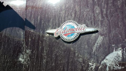 If you see a Dark Cherry Oldsmobile with these badges, it's one of the final 500 built of that model.