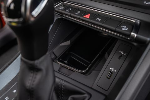 The 2019 Audi Q3 makes great use of its interior space, and borrows much of its styling for the bigger, fancier Q8. The car shown here is equipped with Audi's virtual cockpit, which uses a 12.3-inch high-resolution digital display in place of a conventional instrument cluster. Also shown: Optional orange Alcantara trim inserts, an add-on the available S line sport interior package.