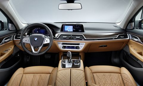 The 2020 BMW 750i xDrive offers paddle shifters on the steering wheel for manual shifting and a rotary dial for infotainment control.