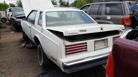 A 1983 Dodge Mirada in a Colorado self-service wrecking yard.