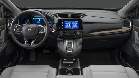 The 2020 Honda CR-V carries most of its interior over from 2019 models, aside from a few minor changes. Hybrid models get a new instrument cluster.