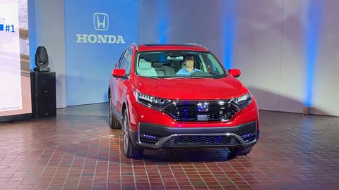 The upcoming 2020 Honda CR-V Hybrid pairs a 2.0-liter Atkinson-cycle inline-four with two electric motors. Total system horsepower is 212. All non-hybrid CR-Vs (shown here in blue) will now get Honda's 1.5-liter turbocharged inline-four, previously only offered on higher-trim vehicles; it's good for 190 hp.