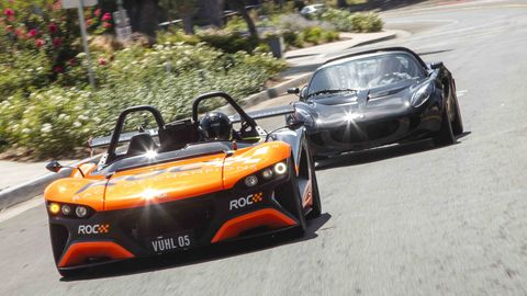 Here theVuhl 05 ROC leads a Lotus Elise on a California street.