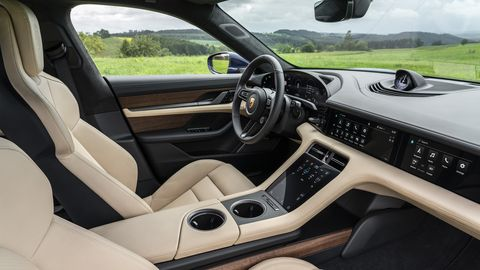 The 2020 Porsche Taycan features a concave digital display to lessen glare.