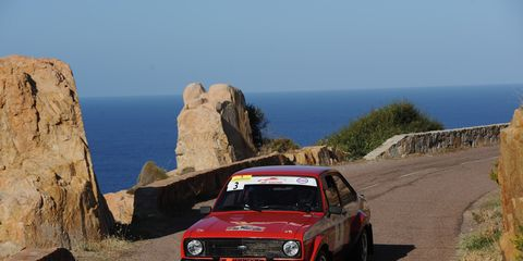 Francois Foulontook advantage of spins and mechanical troubles of several cars ahead of him to drive this Ford Escort Mk2 RS 1800 to overall victory in Corsica, with a real Corsican co-driver - SebatieeMatteinavigating.