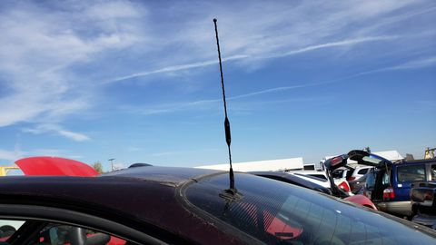 A genuine factory-installed car-phone antenna.