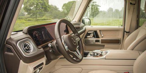 Land vehicle, Vehicle, Car, Motor vehicle, Steering wheel, Rim, Automotive design, Sport utility vehicle, Luxury vehicle, Car seat,