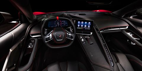 The interior of the 2020 Chevrolet C8 Corvette features buttons for climate, but almost everything else is controlled through the infotainment screen.