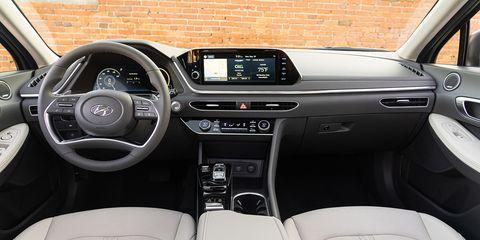 Land vehicle, Vehicle, Car, Center console, Audi, Steering wheel, Personal luxury car, Luxury vehicle, Executive car, Mid-size car,