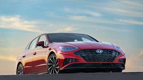 Land vehicle, Vehicle, Car, Automotive design, Mid-size car, Bumper, Performance car, Automotive exterior, Rim, Sky,