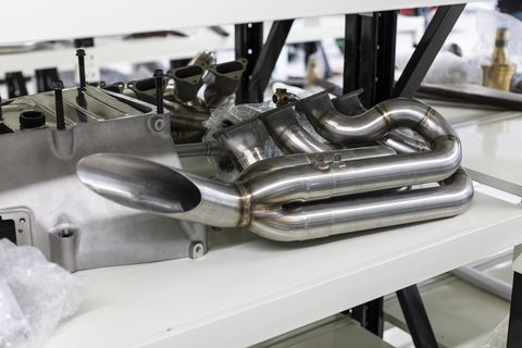 Among the 1,500 acres, near two test tracks, are facilities filled with 3-D printers, autoclaves and other equipment to build the Rodin FZed. In one room, crates of Cosworth V8s.