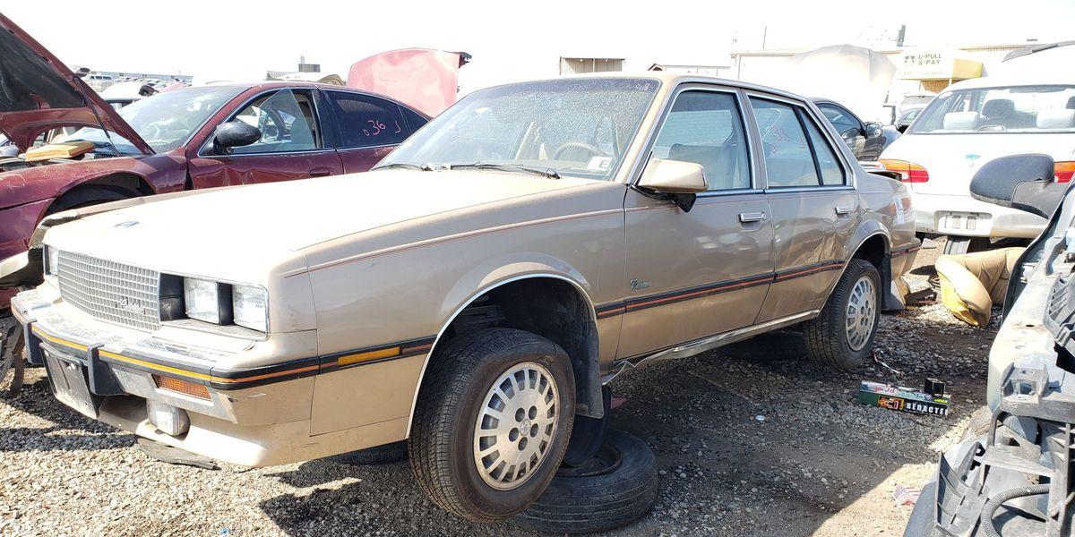 1985 Cadillac Cimarron in Colorado junkyard