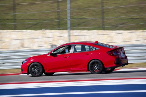 Other than a brake pad change, you're looking at a bone stock 2020 Honda Civic Si lapping Circuit of the Americas. This is the Si sedan in profile.