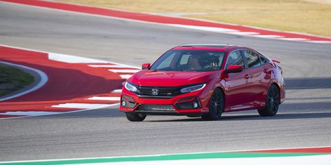 Other than a brake pad change, you're looking at a bone stock 2020 Honda Civic Si lapping Circuit of the Americas. This is the Si sedan.