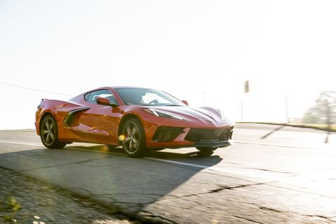 Here's the front three-quarters of the midengine 2020 Chevrolet Corvette Stingray in motion with a nice shadow in the foreground.