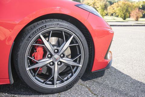 The front wheels pushed to the front corner of the latest Chevrolet Corvette.