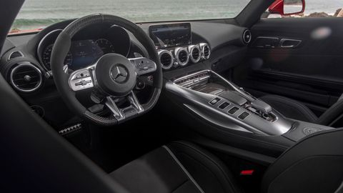 The 2020 Mercedes-AMG GT C gets the updated switchgear and buttons on the console and steering wheel.
