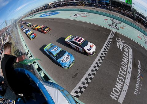 """<span id=""""CT_Main_1_cache_lblCaption"""">Denny Hamlin, driver of the #11 FedEx Express Toyota, lead the field to the green flag to start the Monster Energy NASCAR Cup Series Ford EcoBoost 400 at Homestead Speedway on November 17, 2019 in Homestead, Florida.</span>"""