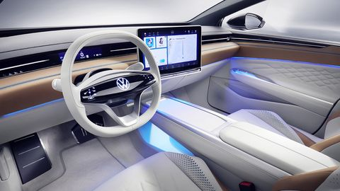 The interior features a large floating screen.