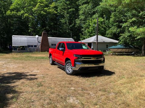 The most controversialstyling of the 2019 Chevrolet Silverado is the front. I don't know looks like truck to me. In background, the boat it's about to tow. And a Quonset Hut. A pre-fabricated building you could buy and build.